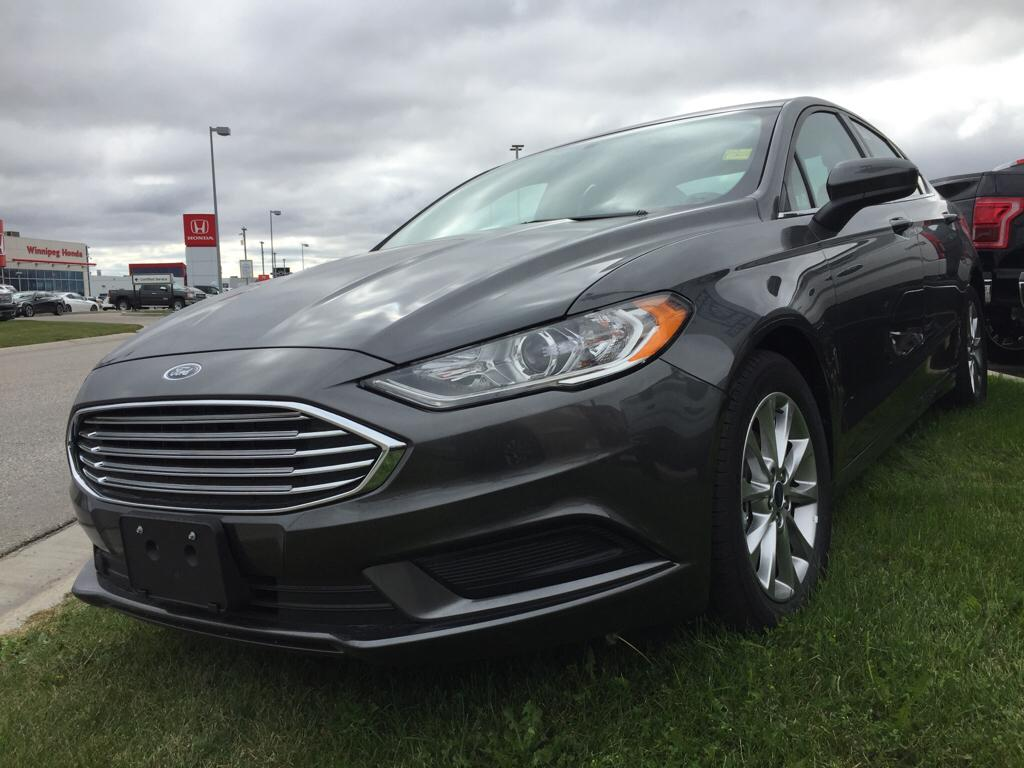 ... Front Wheel Drive 4 Door Car. New 2017 Ford Fusion S & New 2017 Ford Fusion S 4 Door Car in Winnipeg #17P0G02 | Mid-Town Ford markmcfarlin.com