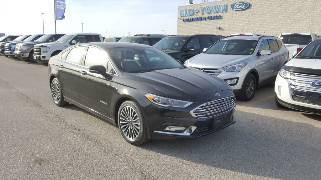 new 2018 ford fusion hybrid titanium fwd 4 door car in winnipeg 18p0r01 mid town ford. Black Bedroom Furniture Sets. Home Design Ideas